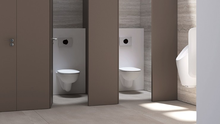 Geberit in-wall toilet systems in a public restroom