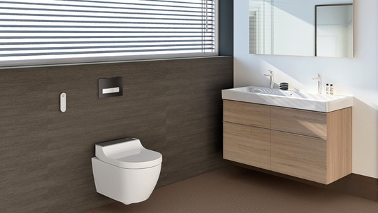 Bathroom with Geberit shower toilet Tuma  and actuator plate Sigma50